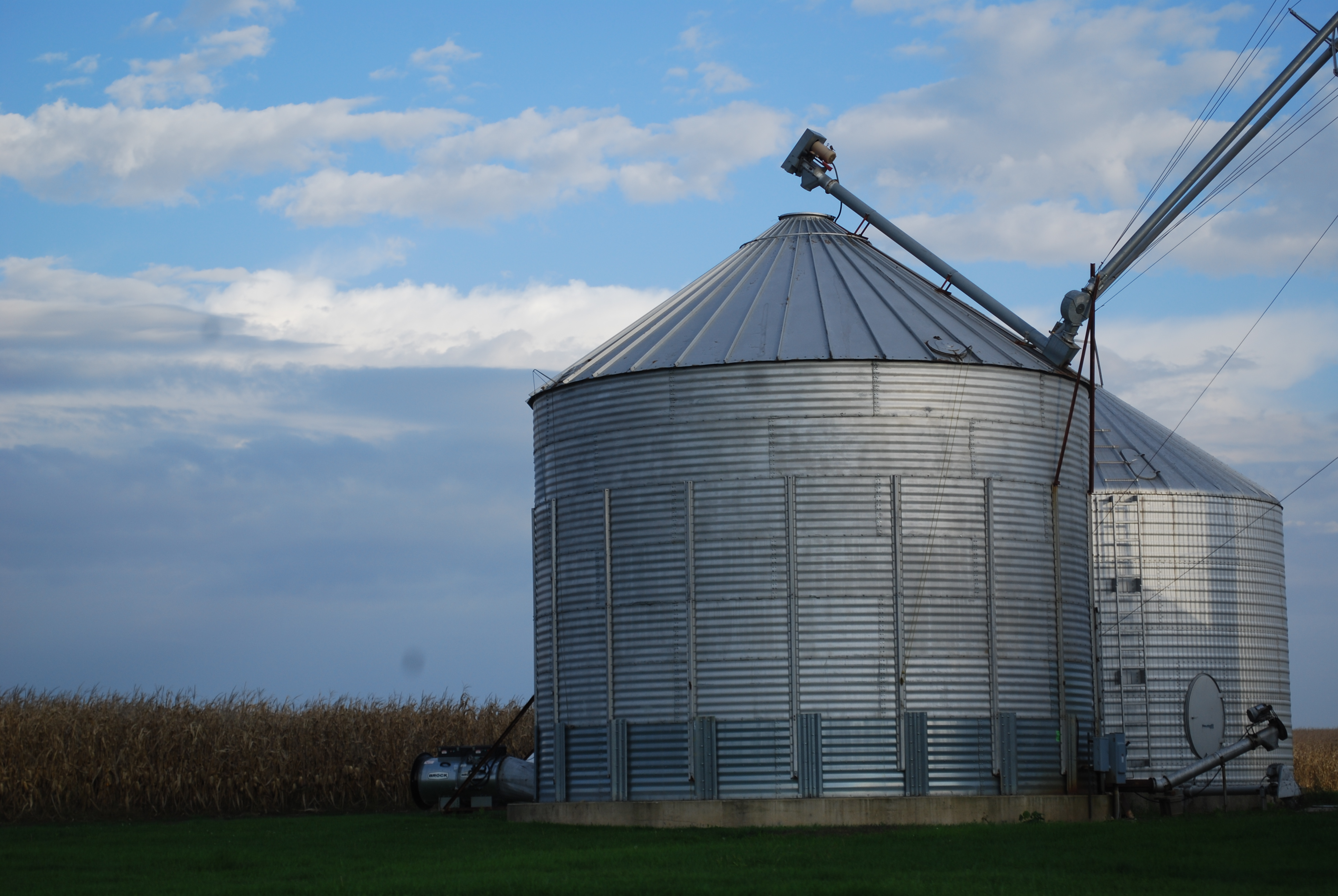 An agronomy blog image showing grain bins during harvest.