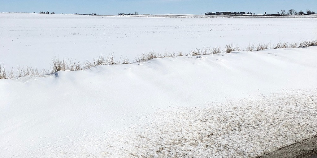 This agronomic image shows Snow-covered fields in Dows, IA.