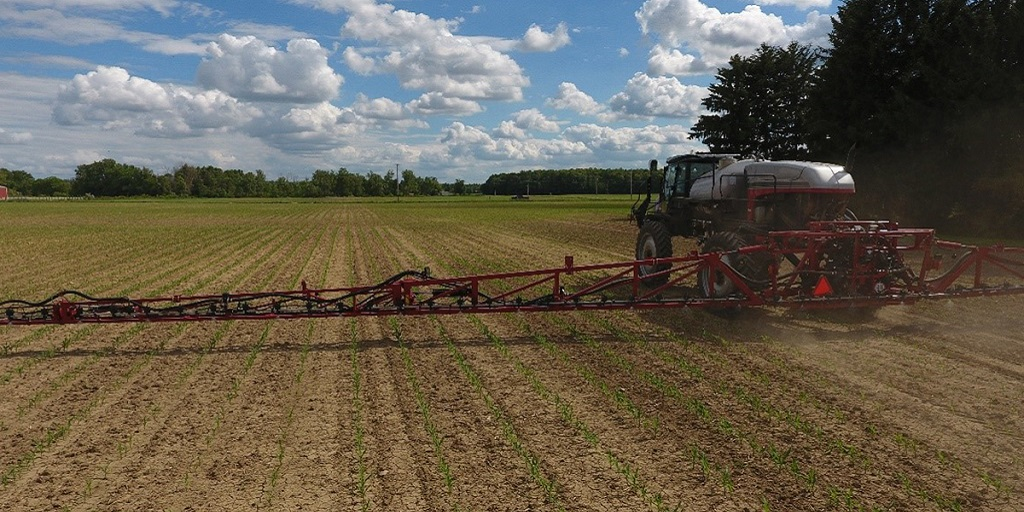 this agronomic image shows a filed being applied with herbicides.