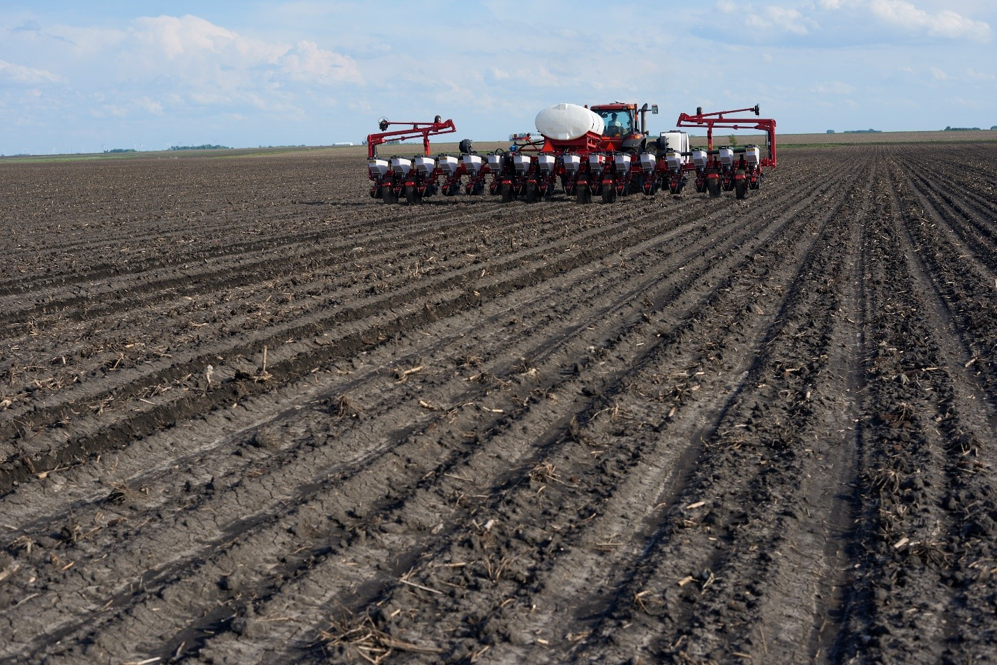 This agronomic image shows a machine planting in a field
