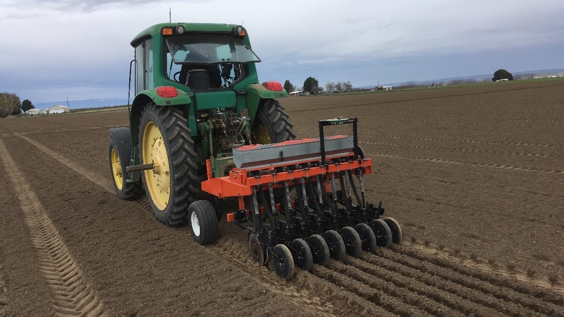 this agronomic image shows a planting machine.