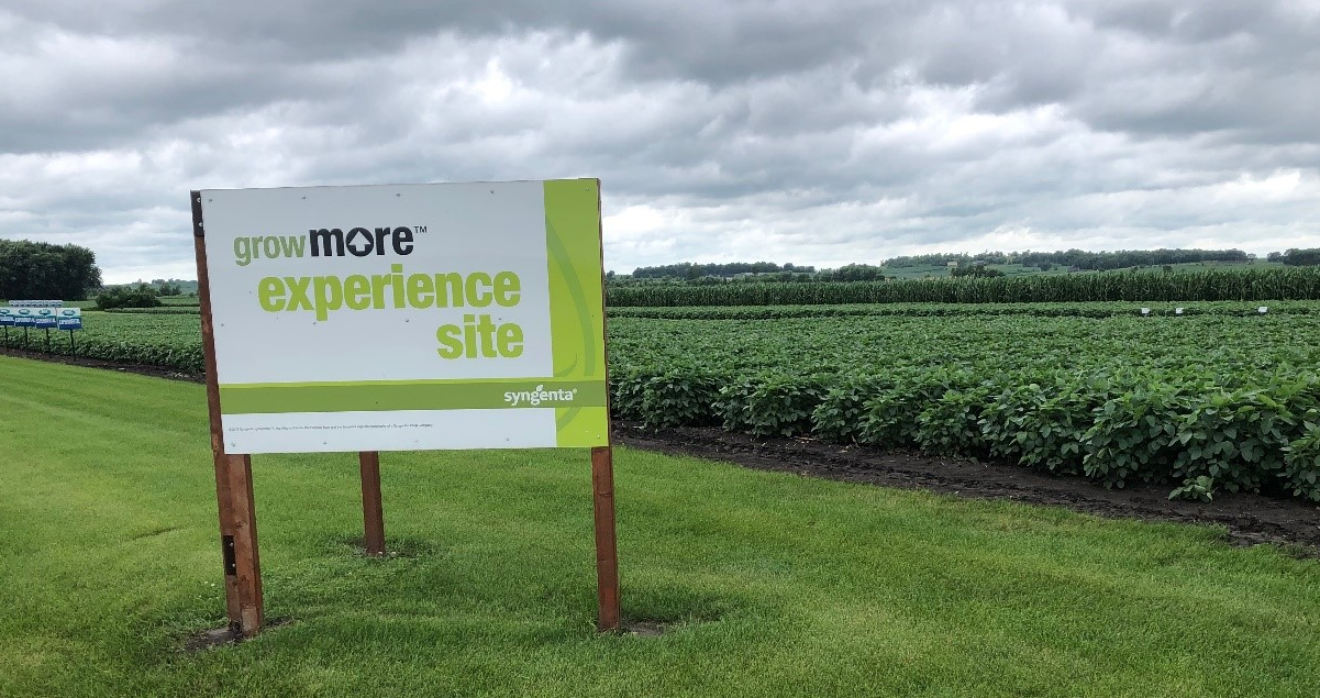 This image shows the Grow More Experience Site sign in front of a field at the Stanton, Minnesota, Grow More Experience testing site.