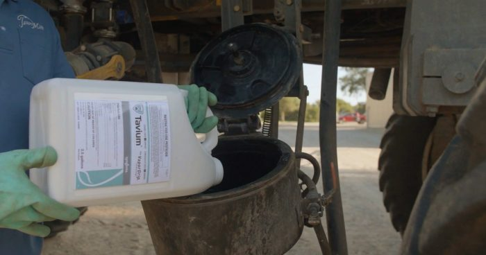 This agronomic image shows Tavium® Plus VaporGrip® Technology herbicide being added to a sprayer